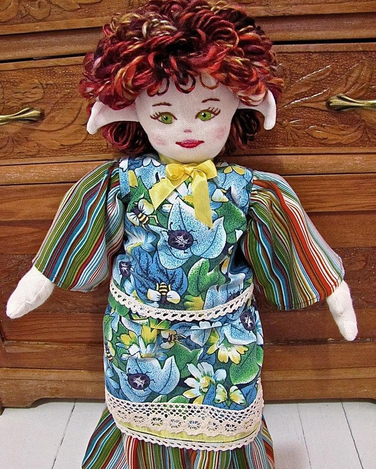 'Wildflower', the fifth faerie in my MaerieFaerie doll collection. A cloth doll made from recycled clothing and fabrics, vintage trims, and thrift store finds. Stuffing is 100% recycled polyester.