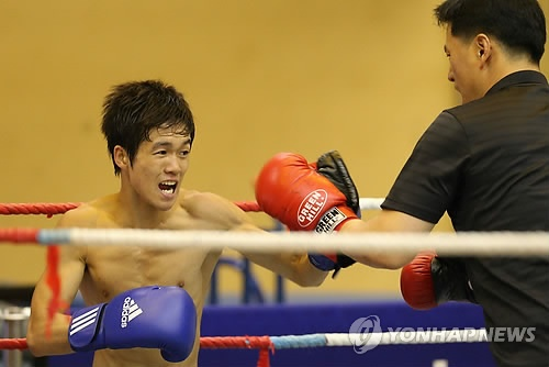 Team Korea Olympic training camp at Brunel University in July 2012 - Boxing training in full swing in the Exercise Studio. Google Image Result for http://img.yonhapnews.co.kr/photo/yna/YH/2012/07/25/PYH2012072500440001300_P2.jpg