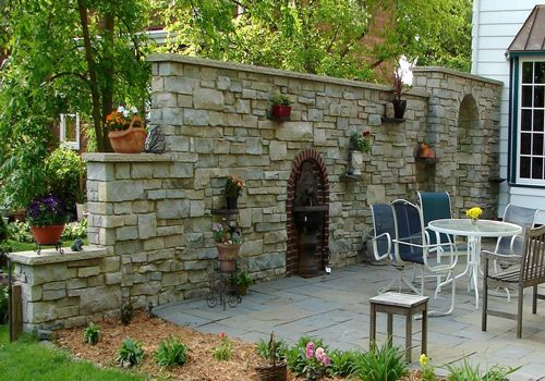 Stone Garden Wall #stone_garden_wall  Great idea for privacy between neighbors or along the monon.