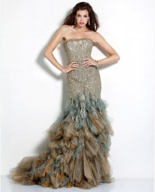 The warm earth tones of this dress make it a work of art for Couture definition