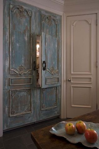 Hiding the refigerator with antique doors? Ummm... YES PLEASE!!