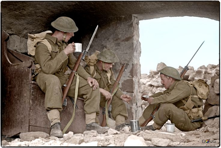 New Zealand soldiers drinking tea during a break in manoeuvres in the Cassino area in Italy, 5 April 1944.