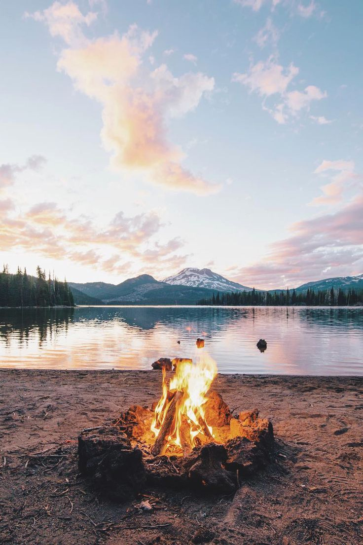 Breathtaking view at sunset, with the added comfort of a warm fire.