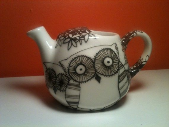 Enjoy your tea in this mini single serve teapot. Hand illustrated/painted in black and white. Fill it with Holiday candies! This makes a