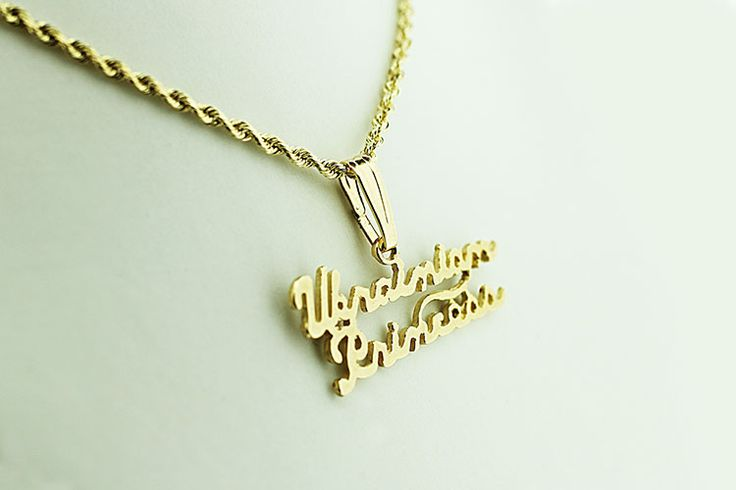 """Beautiful hand-made 14kt gold pendant featuring the words """"Ukrainian Princess"""" in an elegant script makes a wonderful gift for any Ukrainian woman in your life."""