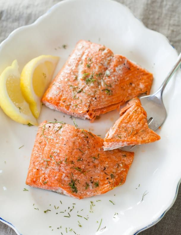 If you're looking for quick and easy, it doesn't get much easier than roasted salmon fillets. In this simple how-to, you'll find tips on cooking Salmon in the Oven. In 20 minutes OR LESS, you'll have a perfect, flaky fillet terrific with just a sprinkle of fresh herbs and a wedge of lemon squeezed over top as you walk to the table.