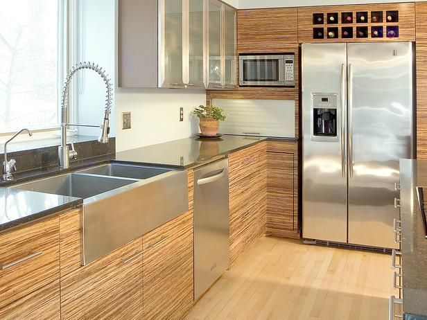 Modern or midcentury modern cabinets are reminiscent of mid 20th century.