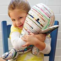 """Download the free pattern to create the adorable stuffed whale featured in April/May '10 """"Salvaged Selvages."""""""