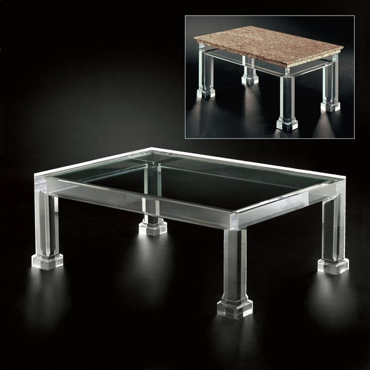 crystal clear glass table with simple architecture and has four feet ornamented and field of table can be made from wood