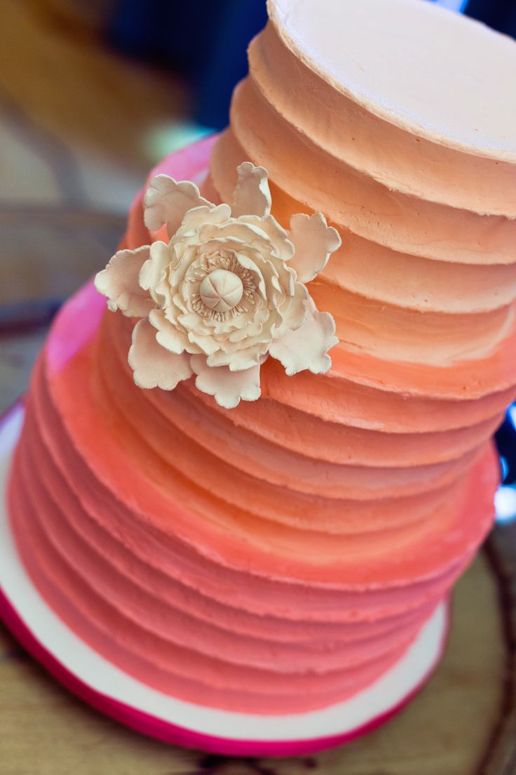 Ombre coral & peach buttercream wedding cake with sugar flower; Baker: Cake-a-chance, Miramichi, NB; Photo cred: Hillary McCormack Photography