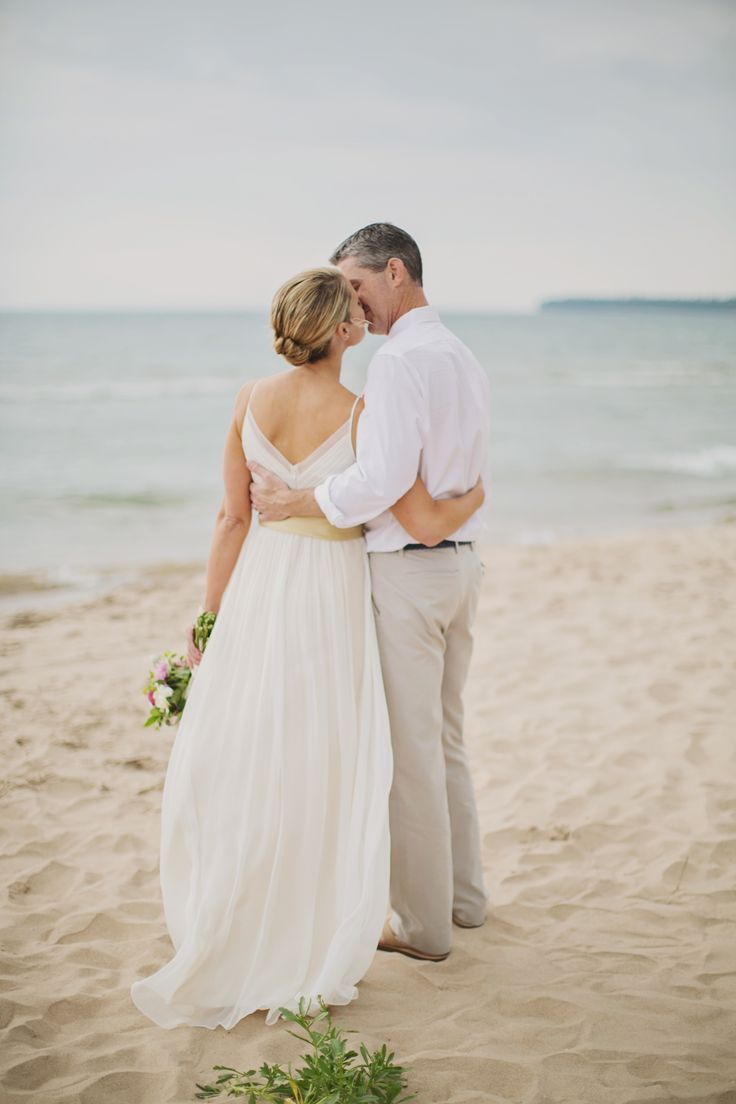 Beach wedding kiss  Photography: erin jean photography - erinjeanphoto.com