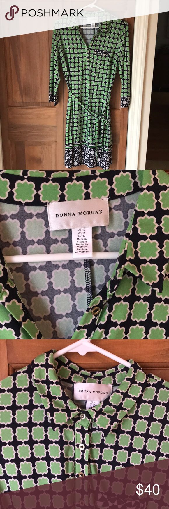 Donna Morgan pattern dress Beautiful 3/4 sleeve dress to wear to work. Worn once to a business meeting with nude flats. Size 10 but fits more like an 8. Super cute pattern and gold buttons that can be worn unbuttoned or buttoned up.  All of my items are in excellent condition from my smoke-free, borderline OCD clean home 😂 Donna Morgan Dresses Long Sleeve