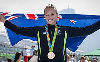 Kiwi kayaker powers to the finish line to become a double Olympic champion.
