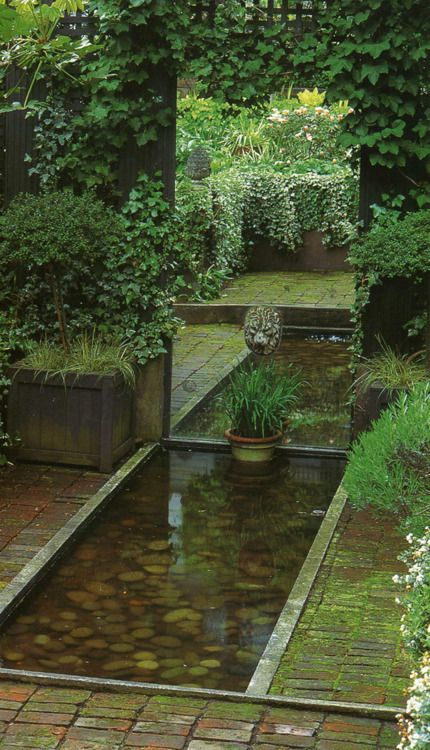 Using a mirror to extend water feature and garden.  What a great idea!