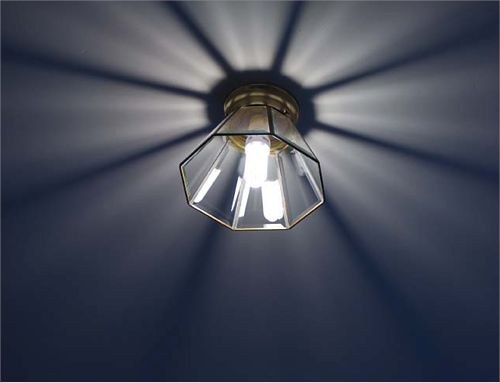 Energy effecient light bulb in ceiling light fixture.