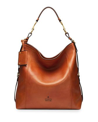 """Loving the """"burnt orange"""" straight from #NYFW in Gucci's new intros. Harness Leather Hobo Bag, Burnt Orange by Gucci at Neiman Marcus."""