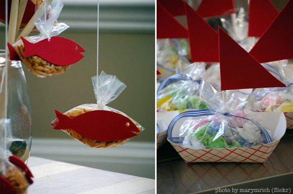 I love the idea of using a dowel rod and string to hold a baggie of goldfish for the favors!