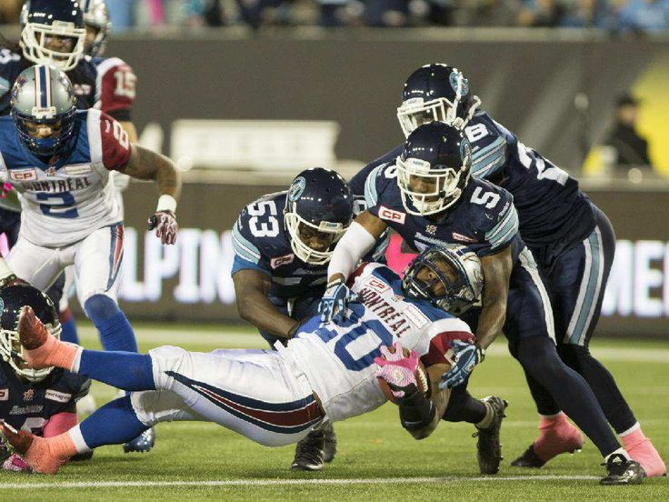 Wk 18 - Oct.23 2015 - Mtl.34 - Argos 2 -Montreal Alouettes running back Tyrell Sutton (20) crosses the line for a touchdown during first half CFL football action against the Toronto Argonauts in Hamilton, Ontario on Friday, October 23, 2015.