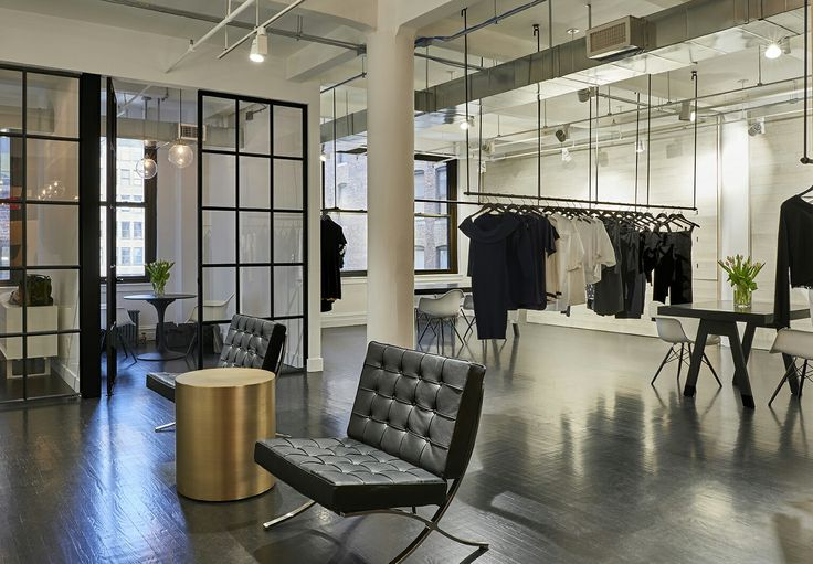 EOA / Elmslie Osler Architect, new showroom, Kendall + Kylie, NYC with blackened steel, white washed wood and custom tables.