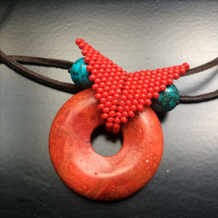 Red owl - beaded necklace with coral donut and tyrkenite eyes.