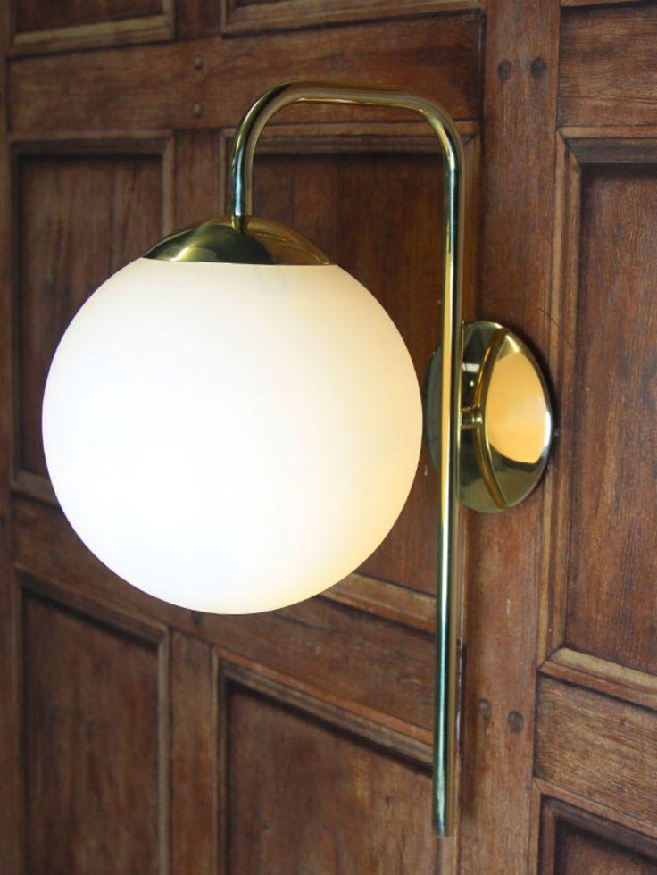 Polished brass wall light with opal glass globe - Chantelle lighting
