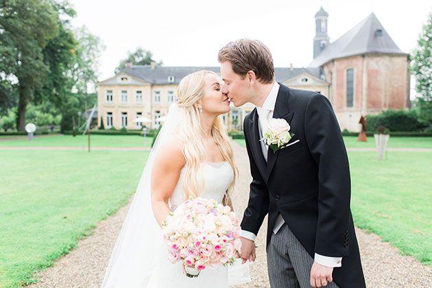 Formal Destination Wedding in the Netherlands, Bride and Groom Outside Venue