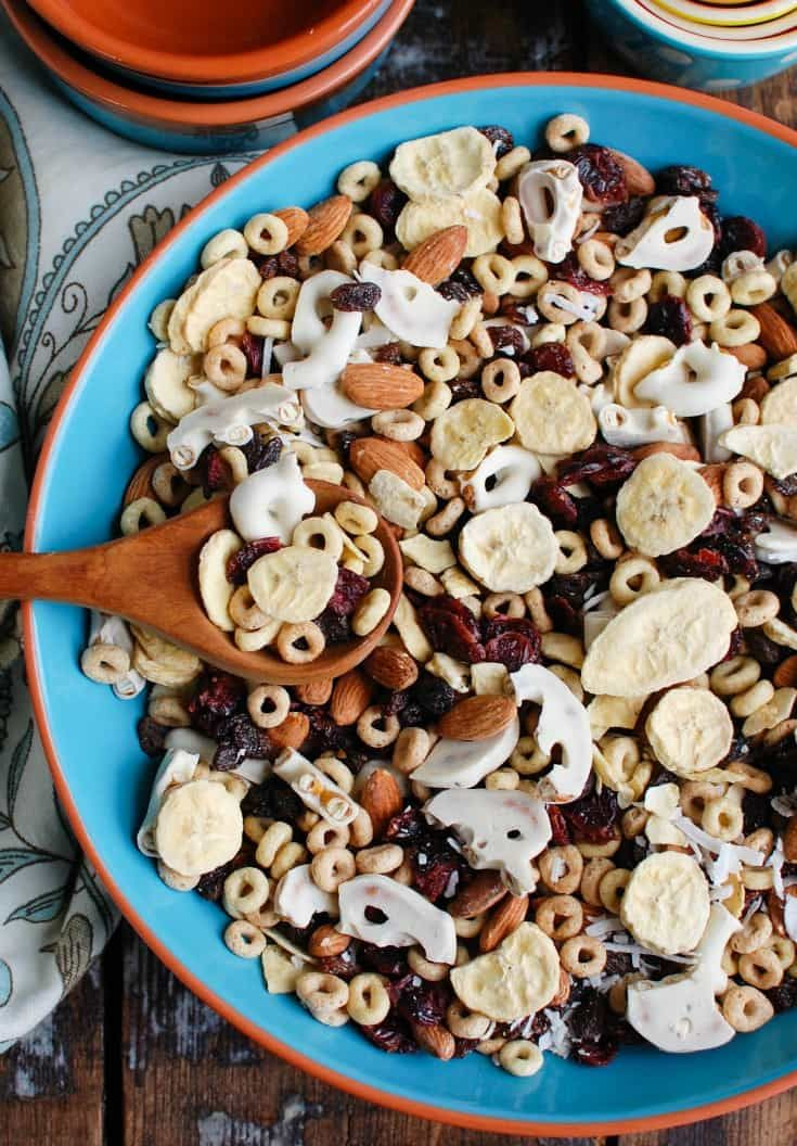 This Easy Breakfast Trail Mix makes a great on-the-go breakfast or snack mixing freeze dried bananas, almonds, dried fruit, yogurt pretzels, cereal.