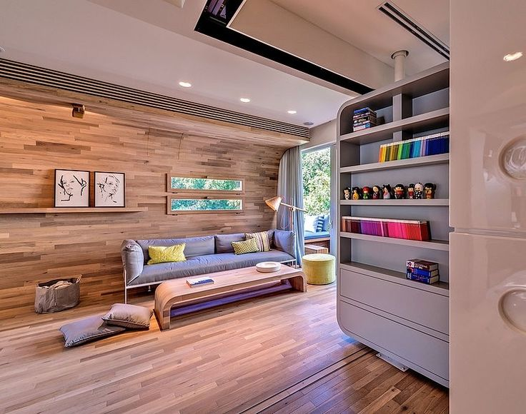 Colorful Details in the Grey Shelves near Tel Aviv Apartment Living Room with Long Grey Sofa,
