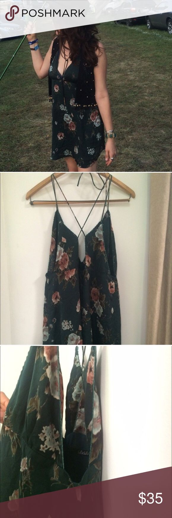 Green Festival Dress This green floral slip dress is so pretty! Fully lined. Has zipper in the back and ties around neck. Can be dressed for any occasion with heels and a jacket, or sandals and a cute bralette! Lulu's Dresses