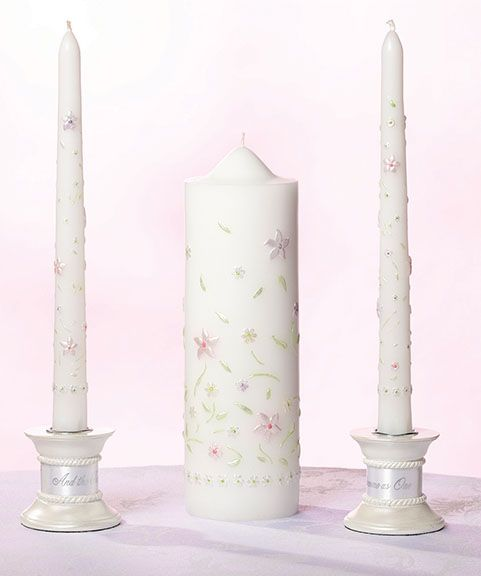 "Lillian Rose Garden Party Unity Candle Set This unity candle wedding set comes with one 8.5"" tall pillar candle and two 9.75"" tall taper candles. All three candles are decorated with wax leaves and flowers in a variety of colors. Price $33.90"