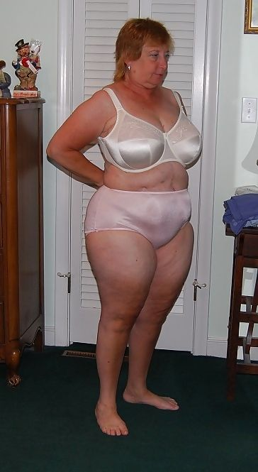 Lovely mature woman with beautiful figure wearing full cut nylon pantie in soft pink with white under wire bra. Stunning !