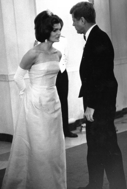 John F. Kennedy and Jackie Kennedy attend a dinner party in Washington, D.C.1962.