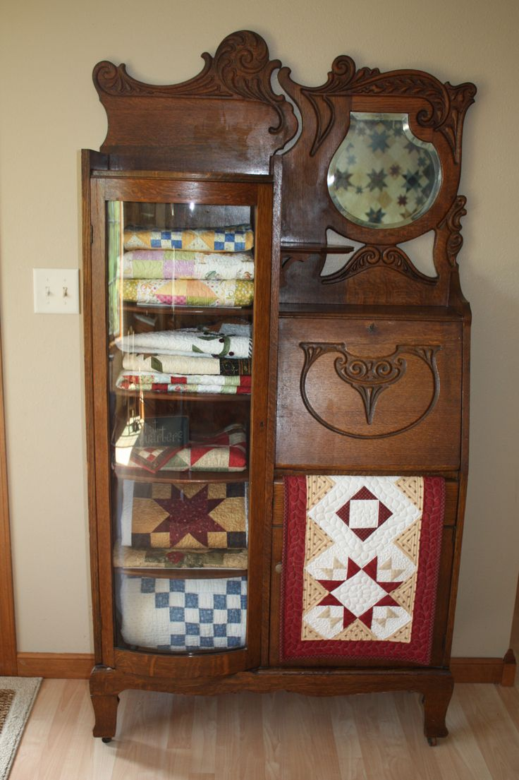 Storing small quilts in the antique secretary my mom just gave me.  Still need to add some decorative items to the top shelf.