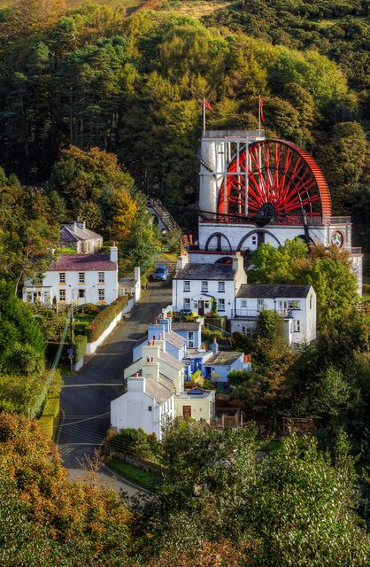 Laxey Village and the Lady Isabella Water Wheel, Isle of Man, England (1854) is the largest working waterwheel in the world. It was built in to pump water from the Glen Mooar part of the 'Great Laxey Mines' industrial complex.