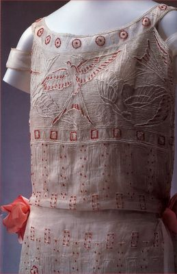 Embroidered Day Dress by Paul Poiret, 1923. White linen embroidered with white thread and tiny red glass beads.