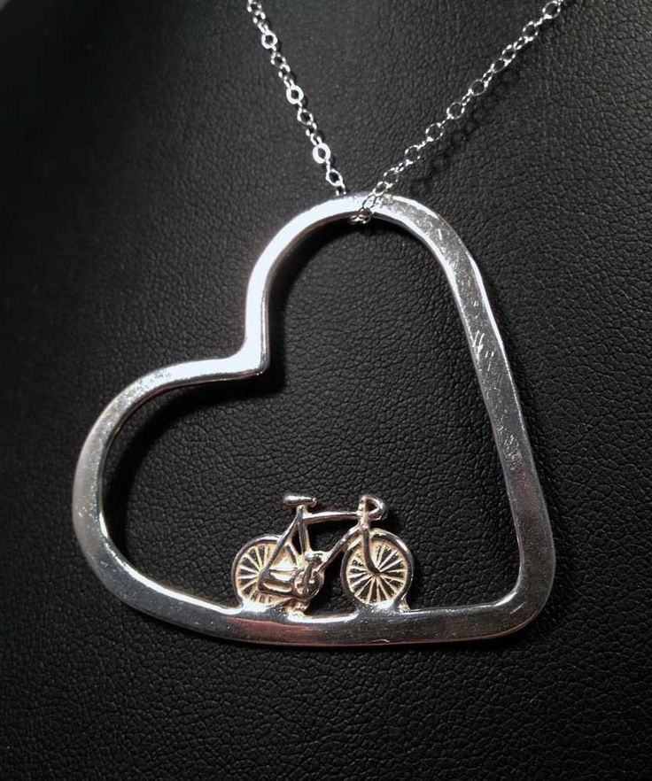 If you have cycling in your heart this is the most symbolic piece weve made yet. Bike in my heart is elegant and sweet. This comes with an stainless steel chain and as you can see in the photo it will slip on to most any chain you already have. All 925 sterling silver and just darling to wear on a longer chain.  *************************************************************************************************** All designs and creations are copyright property of Velo Gioielli LLC…