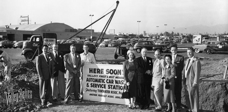 Panorama Market back parking lot with new construction of Automatic Car Wash & Service Station. Circa 1940's
