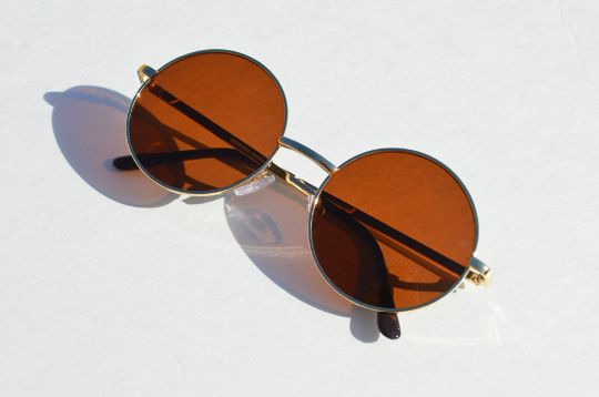 Sunglasses 90s John Lennon Round in Gold UNISEX- Retro Vintage Eyewear Fashion. 100% UV protection. Comfortable and classic.This item measures 5 1/4 inches from side to side. And 2 inches in diameter.Each sunglasses once purchased will be packed with most care. Shipping in the U.S.A takes 5-7 days depending where you live.For International 10-30 days also depending on your country policies.