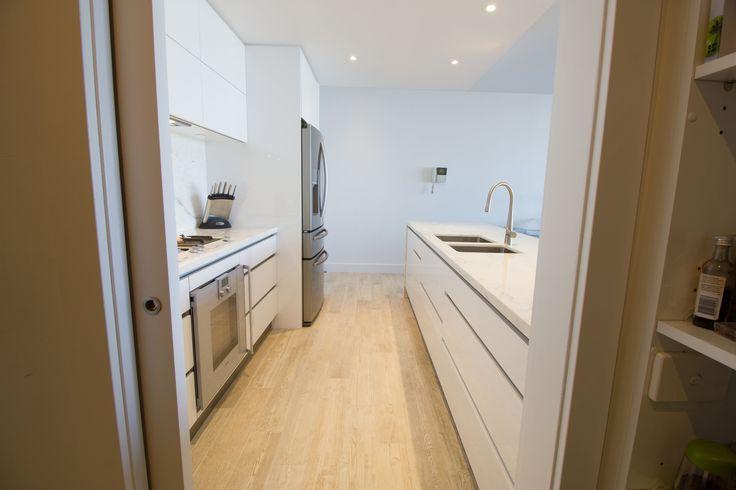 Galley kitchen. No handles www.thekitchendesigncentre.com.au