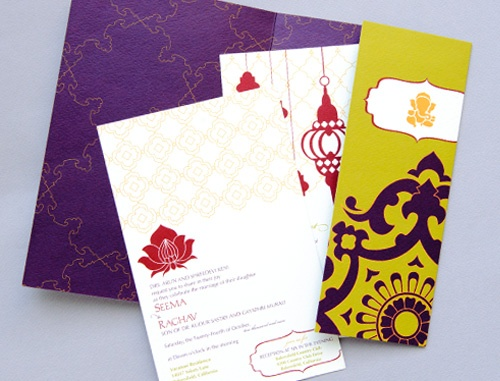 Indian wedding invitations with green and purple folder.