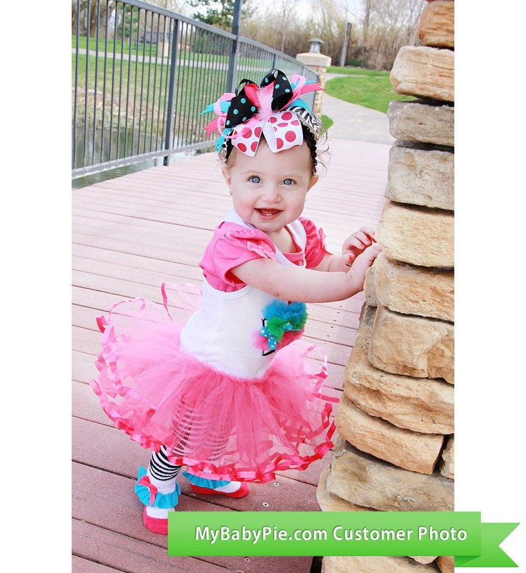 Wild Child Cupcake Tutu Dress by Mud Pie with matching bow. Outfit is $29.95 at MyBabyPie.com.