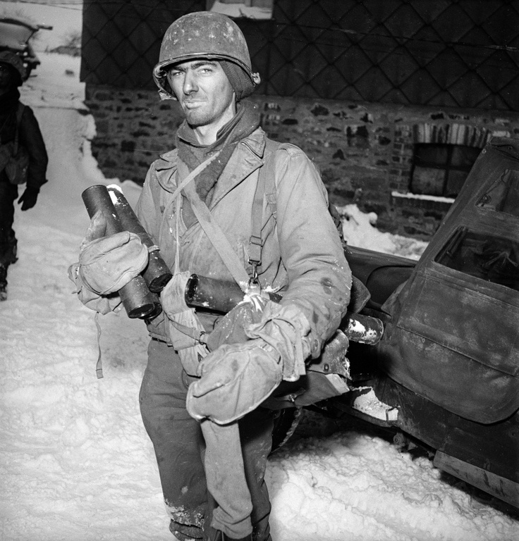 An exhausted American soldier just back from the front lines near the town of Murrigen during the Battle of the Bulge. With victory at the Battle of the Bulge on January 25, 1945, the final triumph over Nazi Germany was in reach; Allied forces pressed their advantage and began the last push toward Berlin. On May 7, Germany agreed to an unconditional surrender.
