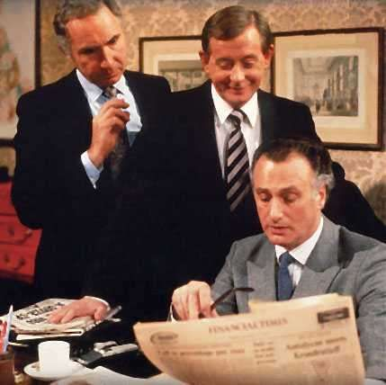 The three main characters in the Minister's Office of the Department of Administrative Affairs: Sir Humphrey Appleby (Nigel Hawthorne), Bernard Woolley (Derek Fowlds) and Jim Hacker (Paul Eddington)