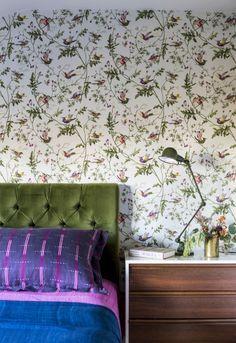 green velvet headboard//floral wallpaper