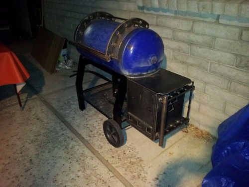 Reverse Flow Smoker by Danoj77 -- Homemade reverse smoker constructed from a surplus air compressor tank, steel plate, and tubing. http://www.homemadetools.net/homemade-reverse-flow-smoker