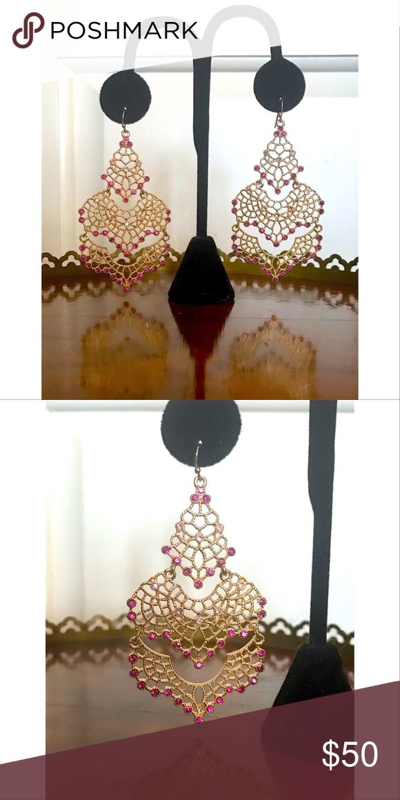 "Neiman Marcus Chandelier Earrings Beautiful chandelier earrings purchased from Neiman Marcus. Fuschia colored crystal, gold wire work. 3"" drop. Never worn. Neiman Marcus Jewelry Earrings"
