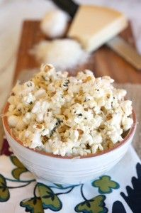 Just put a few pats of butter and a drizzle of extra virgin olive oil in a pan with fresh garlic.Let it sizzle for a few minutes so the garlic softens and infuses the butter, which will in turn coat the popcorn. Then sprinkle in a few herbs. After its tossed on the popcorn, sprinkle in the Parmesan cheese.