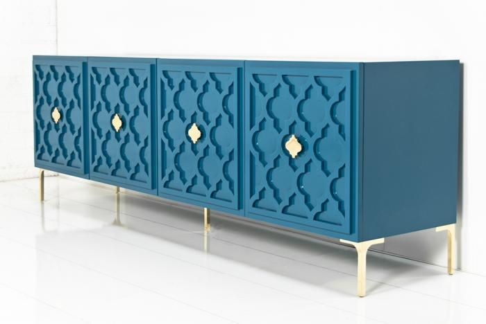The Tangier Credenza is simply stunning. In a grand color, suggestive of the majestic peacock's plumes, this item makes a significant statement. Raised trellis motifs across the entire face of the credenza, as well as the delicate, brass dipped Marrakesh hardware and legs add a sense of airy elegance.