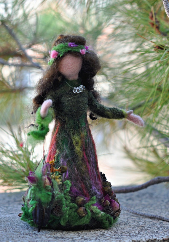 Sweet--has a seed pod for her parasol, bits of flora all around.  Needle felted Waldorf Love Forest Maiden soft by darialvovsky, $48.00