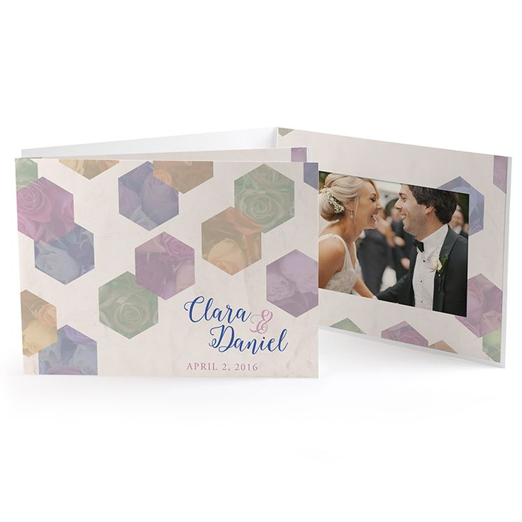 Earthy and elegant, this special event photo holder is a tasteful blend of modern and traditional design. Colorful roses are subdued in colorful, pastel hexagons on a crinkled, cream background. Your names are written in blue in a whimsical script font. The message on the back cover is standard. Perfect for a sophisticated rustic wedding, chic business event, or spring-time event.